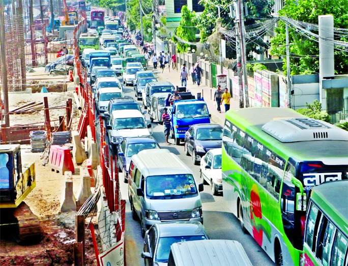 Hundreds of vehicles got stuck in a massive traffic gridlock in the capital as roads being narrowed down due to development works and frequent DU students agitation at Shahbagh. This photo was taken from Banglamotor area on Sunday.
