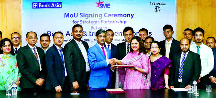 Md Arfan Ali, President and Managing Director of Bank Asia Ltd and Sharawwat Islam, Managing Director of Truvalu enterprises Ltd, exchanging an agreement signing document at the bank's corporate office in the city recently.