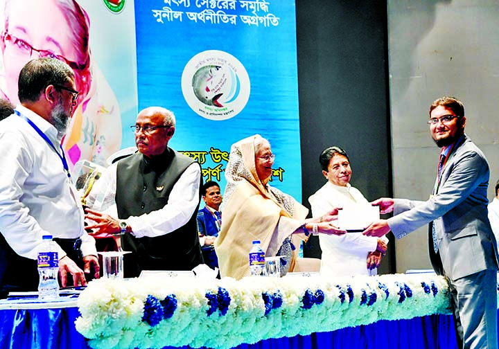 Prime Minister Sheikh Hasina presenting National Fisheries Award to Mostofa Al Rajib, Upazila Fisheries Officer, Betagi , Barguna  for the latter's contribution in Fisheries Sector at a ceremony held recently in the auditorium of  Krishibid Institution, Bangladesh in the city on the occasion of National Fisheries Week.