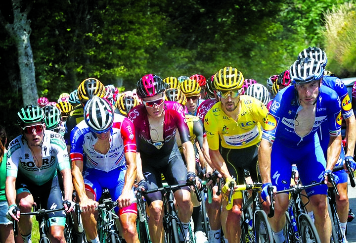 The pack with France\'s Julian Alaphilippe wearing the overall leader\'s yellow jersey rides during the fifteenth stage of the Tour de France cycling race over 185 kilometers (114,95 miles) with start in Limoux and finish in Prat d\'Albis, France on Sunday.