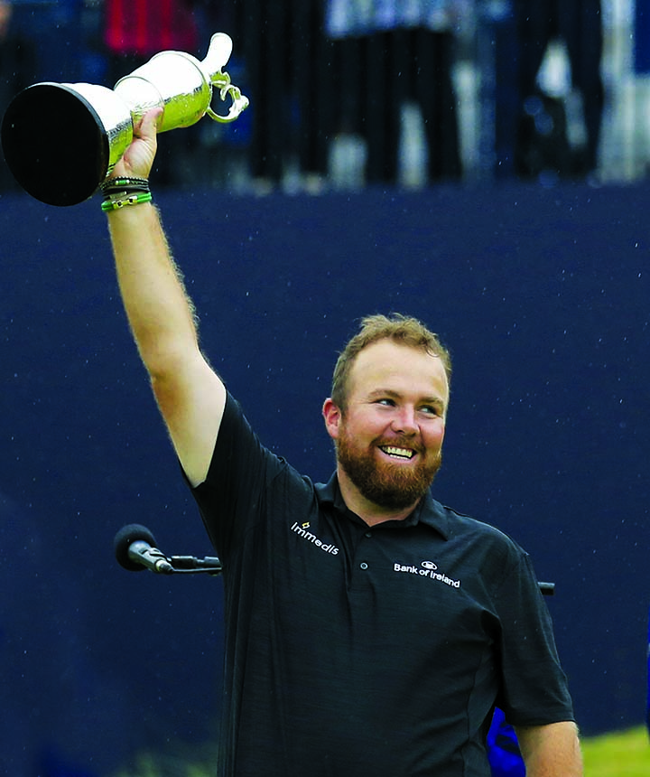 Lowry weathers storm to win British Open and first major