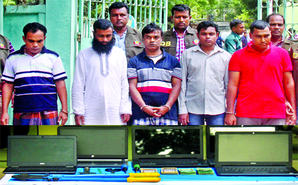 Five alleged criminals were arrested by DB police with five laptops, two private cars and Tk 1,90,000 in cash from city's Bangshal area. This photo was taken from in front of DB office on Monday.
