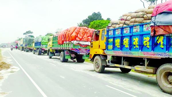 Hundreds of vehicles along with goods laden truck got stuck near Shimulia-Kathalbari navigation route as ferry services were disrupted due to heavy current in River Padma on Monday.-