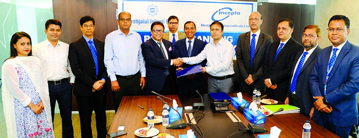 Abdul Aziz, Additional Managing Director of Shahjalal Islami Bank Ltd and Naimul Huda, General Manager of Finance & Accounts of Incepta Pharmaceuticals Ltd, exchanging an agreement signing document at bank's corporate office in the city on Tuesday.  Bank's Managing Director  M Shahidul Islam, Deputy Managing Directors M Akther Hossain, Mian Quamrul Hasan Chowdhury and Imtiaz U Ahmed, among others, were present. Under the deal, all employee of the company can open their bank account in the bank without keeping any initial deposit and will enjoy other Banking facilities.