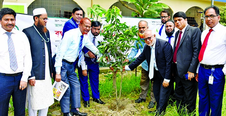 Md Fazlul Karim, Deputy Managing Director of Al-Arafah Islami Bank Ltd, inaugurating 'Tree Plantation Campaign 2019' at Chunkutia Girls High School of South Keranigonj on Tuesday. Bank's EVP Manir Ahmad and Principal of the school K M Elias, among others, were present.