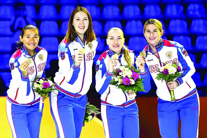 Inna Deriglazova, Anastasiia Ivanova, Larisa Korobeynikova and Adelina Zagidullina of Russia celebrate with their gold medals after they defeated Italy in the final of women's foil team competition of the FIE World        Fencing Championships in Budapest, Hungary on Monday.