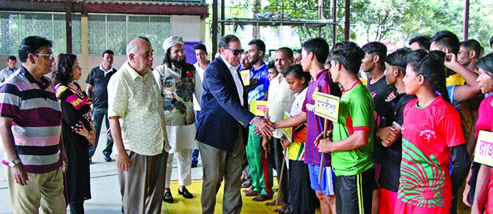 Secretary General of Bangladesh Olympic Association Syed Shahed Reza being introduced with the participants of the RDDL National Junior (Boys' & Girls') Wrestling Competition at the Shaheed (Captain) M Mansur Ali National Handball Competition on Tuesday.