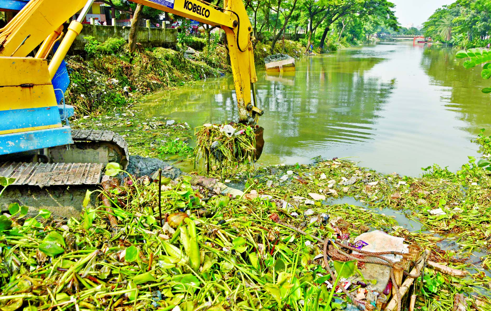 Dhaka South City Corporation authority removing waste to keep free from dengue menace. This photo was taken from city's Matuail canal on Tuesday.