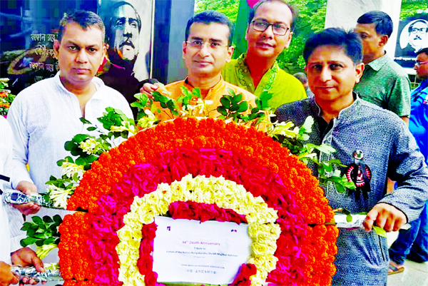 China-Bangla Friendship Association (CBFA) led by its President  Dr Monouar Hasnat Khan and General Secretary Dr S.M Shahidul  Islam placing wreaths at the Memorial Plaque of  Father of the Nation Bangabandhu Sheikh Mujibur Rahman at  32 , Dhanmondi in the city on Thursday marking National Mourning Day .
