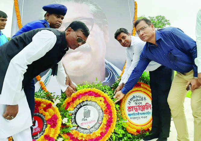 BHANGURA (Pabna): UNO Syed Ashrafujjaman, Upazila Panel Chairman Golam Hafiz Ranju, OC Md. Masud Rana and Bhangura Press Club President Prof Mahbub-Ul- Alom placing wreaths at the monument of Bangabandhu in observance of the National Mourning Day on Thursday.