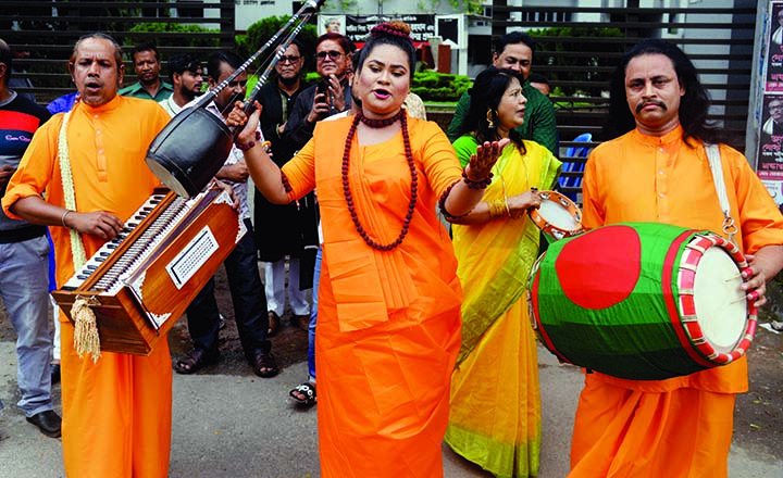 Folk artistes staged a mass awareness campaign with a view to preventing dengue. The snap was taken from in front of the Jatiya Press Club on Saturday.