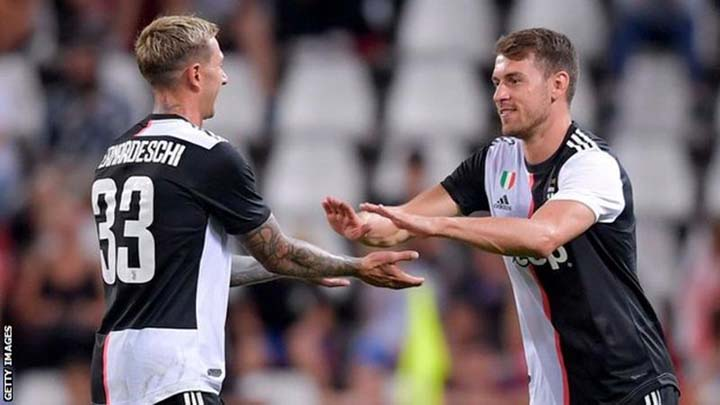 Aaron Ramsey (right) comes on in place of Federico Bernardeschi to make his Juve debut against Serie C side Triestina in their final pre-season friendly at Milan on Saturday.