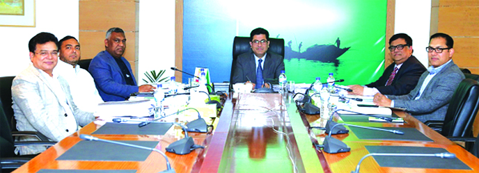 Barrister Sheikh Fazle Noor Taposh MP, EC Chairman of Modhumoti Bank Limited, presiding over its 86th meeting at the bank's head office in the city recently. Mohammad Ismail Hossain, Managing Director of Sharmin Group, Salahuddin Alamgir, Chairman of Labib Group, Ahasanul Islam Titu MP, Director of Mona Financial Consultancy& Securities Limited, Humayun Kabir Bablu, Director of Bengal Group and Md. Shafiul Azam, CEO of the bank were present.