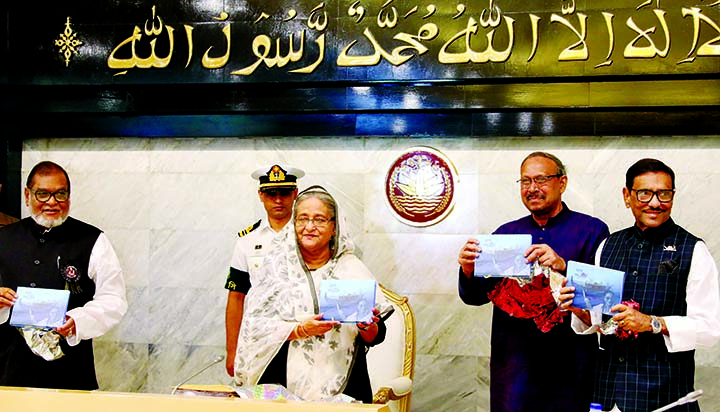 Prime Minister Sheikh Hasina along with other distinguished persons holds the copies of a book titled 'Swapna Panshi' written by Science and Technology Minister Yafesh Osman at its cover unwrapping ceremony at the beginning of cabinet meeting on Monday. The book was dedicated to Prime Minister.