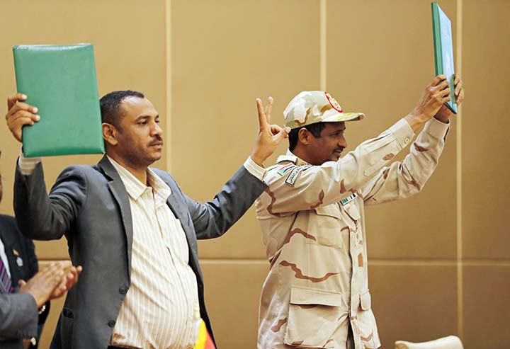 Sudanese army and civilians seal interim power-sharing deal
