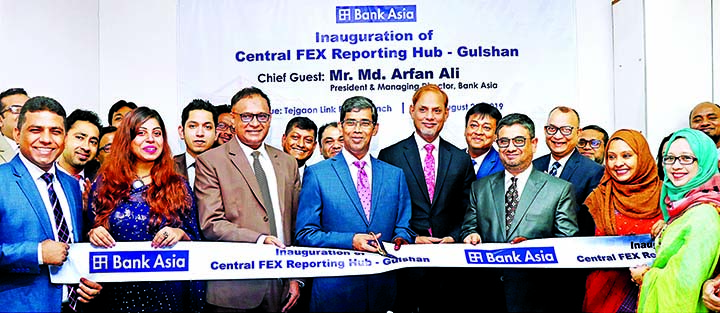 Md. Arfan Ali, Managing Director of Bank Asia Limited, inaugurating its Reporting Hub to ensure automated reporting of foreign trade related transactions for secured customer service at Tejgaon Link Road branch of the bank in the city on Tuesday. Mohammad Borhanuddin, Md. Sazzad Hossain, DMDs and Md. Zia Arfin, Head of International Division of the bank were also present.