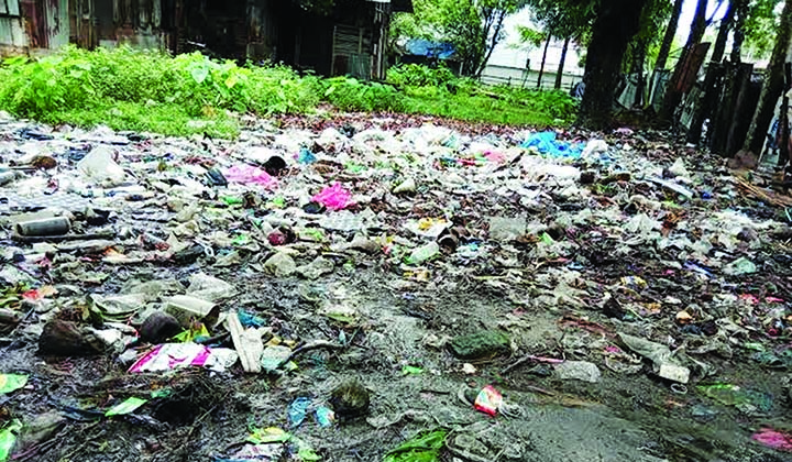 PATUAKHALI: Piling of garbage are seen infront of staff quarter of Kalapara Land Office. This snap was taken on Monday.