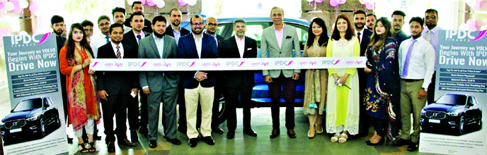 Mominul Islam, CEO of IPDC Finance Limited and Hossain Khaled, Managing Director of Anwar Group Limited inaugurating the Volvo showcase offer at IPDC office premises in the city recently. IPDC jointly brought the auto loan offer with world-renowned automobile company Volvo.