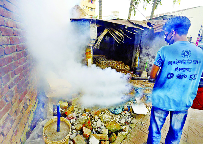 A Dhaka North City Corporation (DNCC) employee with a fogger spraying the newly imported insecticide at Mirpur in city on Wednesday in an effort to kill Aedes mosquitoes.