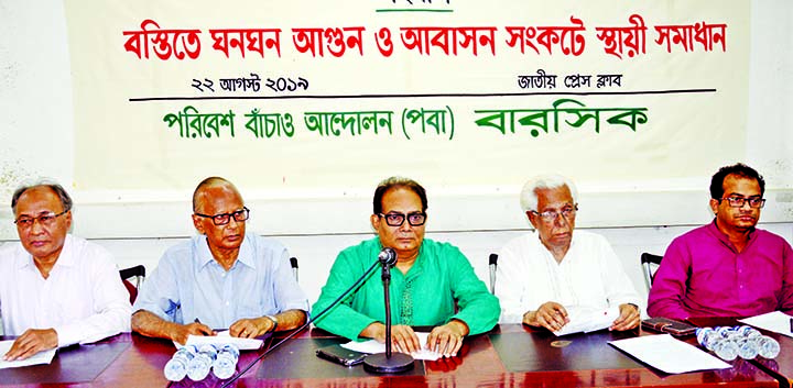 Chairman of Save The Environment Movement Abu Naser Khan speaking at a dialogue on 'Fire in Slums and Permanent Solution of Residential Crisis' at the Jatiya Press Club on Thursday.