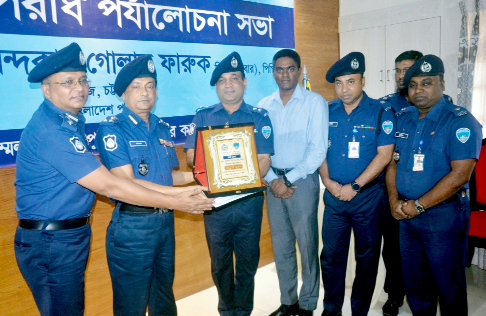 Noor -E -Alam Mina, SP ,Chattogram receiving  best  District Award from DIG Chattogram Range Khandoker Golam Faruque at District Police Lines on Tuesday.