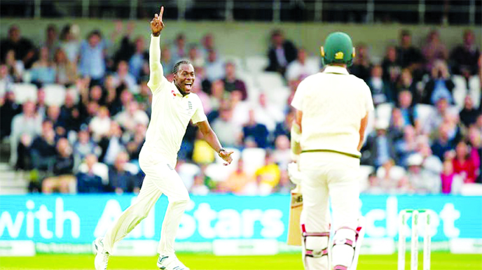 England's Jofra Archer celebrates after taking his 5th wicket, that of Australia's Pat Cummins (right) caught by Jonny Bairstow for 0 on the first day of the 3rd Ashes Test at Headingley in Leeds, England, on Thursday.