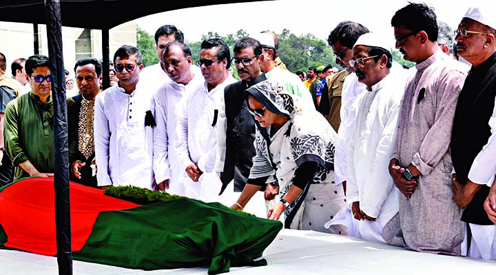 Awami League President and Prime Minister Sheikh Hasina along with party colleagues paid tributes to Freedom Fighter, former Parliament Member and Adviser to Mujib Nagar Government Prof Muzaffar Ahmed by placing wreaths on his coffin at the South Plaza of Jatiya Sangsad Bhaban on Saturday.