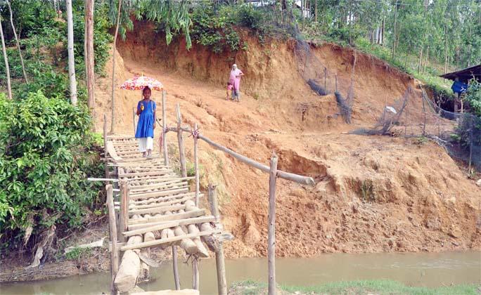 Damaged  road at Kanchan Nagar in  Chandanaish Upazila needs immediate repair. This snap was taken yesterday.