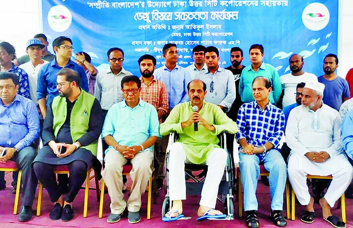 DNCC Mayor Md Atiqul Islam speaking as Chief Guest at an dengue awareness programme organised by Sampreeti Bangladesh in front of Gulshan No 2 DNCC Market yesterday.