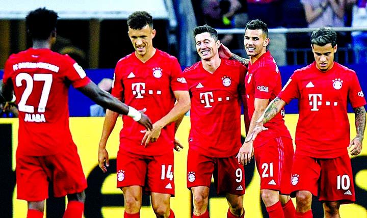 Lewandowski hits hat-trick as 'happy' Coutinho makes Bayern bow