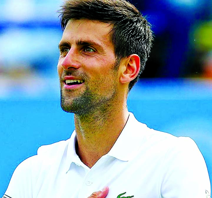 Djokovic motivated by talk of catching Federer in Slams