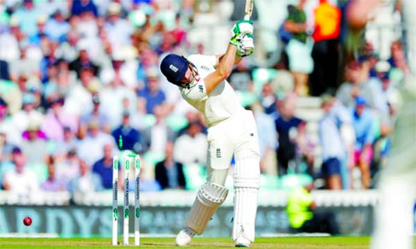 England's Jos Buttler is bowled by Australia's Pat Cummins during the second day of the 5th Ashes Test between Australia and England at the Oval in England on Friday.