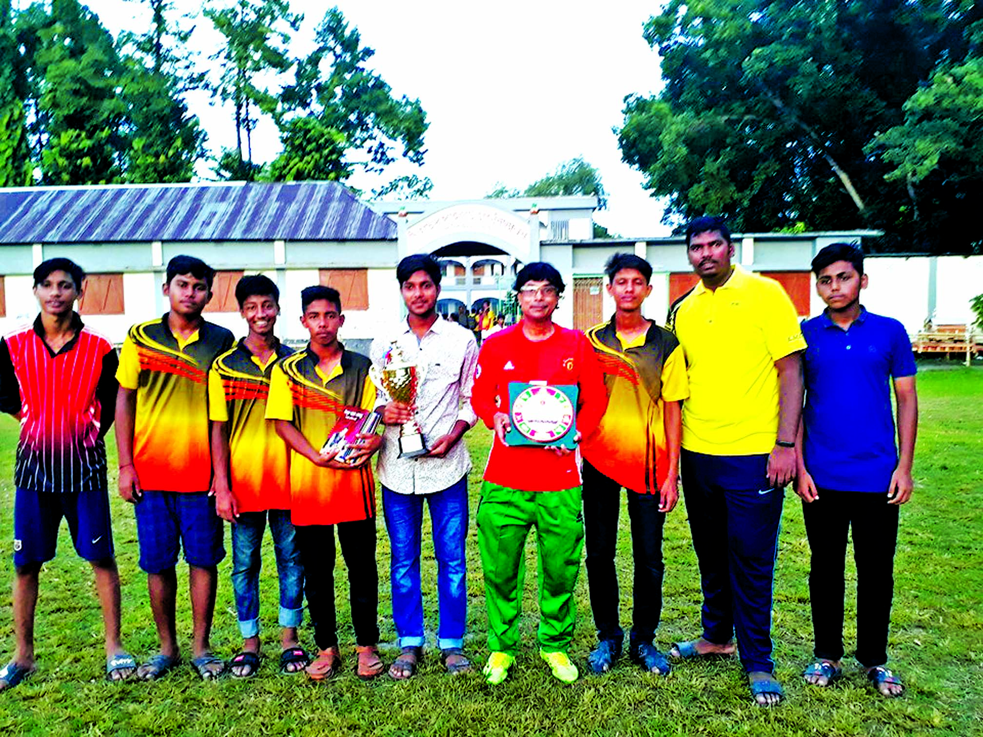 Members of Singair Government High School team, the champions in the Handball (Boys') Competition (upazila level) of the Bangladesh School & Madrasa Summer Sports Competition pose with the trophies at Singair Government High School Ground in Singair upazila, Manikganj district recently.