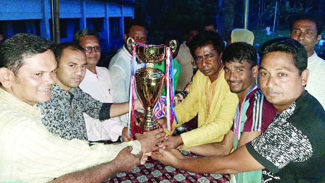 BARAIGRAM (Natore):  Md Shariaj, DC, Natore distributing  trophy of the  final Bangabandhu Football Tournament at Tirail High School ground in Baraigram on  Saturday