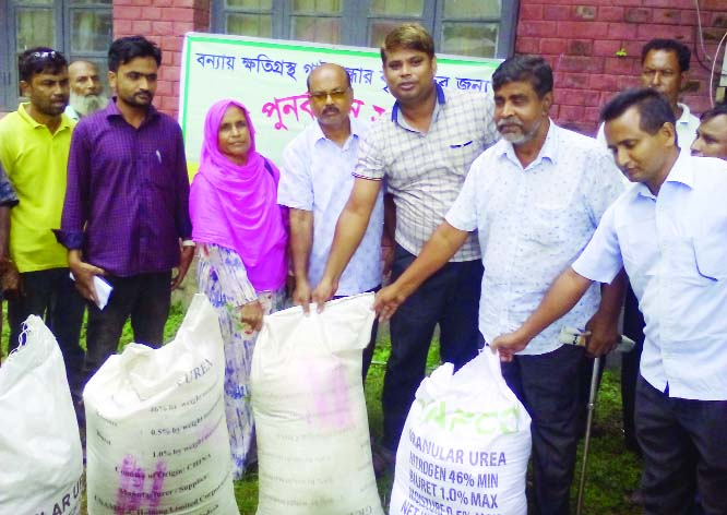 SAGHATA (Gaibandha): AK M Moniruzzaman, Upazila Agriculture Officer inaugurating fertiliser distribution programme  among the flood- hit farmers at Saghata Upazila recently.