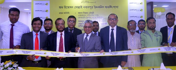Nizam Chowdhury, Chairman of NRB Global Bank Limited, inaugurating its Islami Banking Branch operations at Dollai Nawabpur in Comilla recently. Syed Habib Hasnat, Managing Director, Md. Mostafizur Rahman Siddiquee, AMD, other senior officials of the bank and local elites were also present.