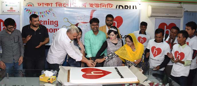 Mezbah Uddin Sarker Rubel, CEO of Heartsbook (an alternative Social Media flat form of Face book), inaugurating its commercial operation in Bangladesh through cutting a cake at Dhaka Reporter's Unity in the city on Sunday. Mahabuba Mohammad Babon Sarker, Vice-Chairman and other executives of the company were also present.