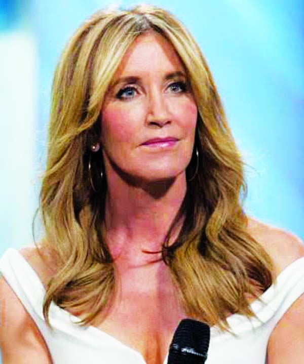 Felicity Huffman has been sentenced to 14 days of prison