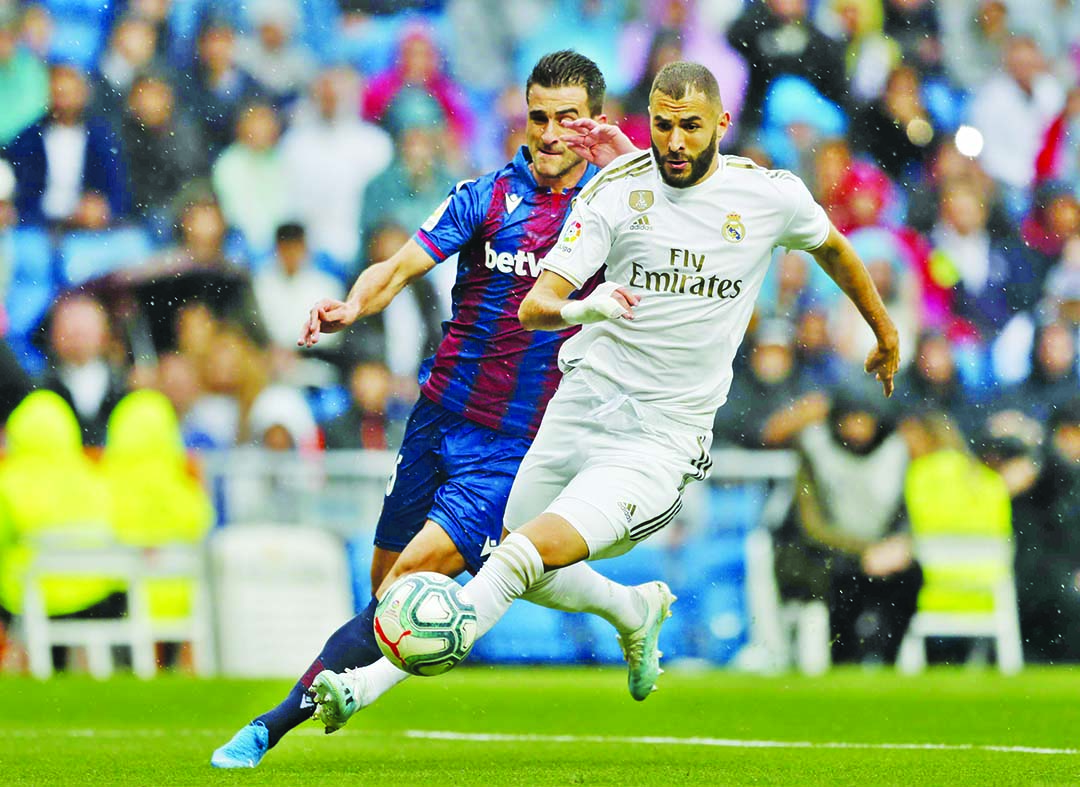 Benzema scores twice in 'game of two halves' for Real Madrid