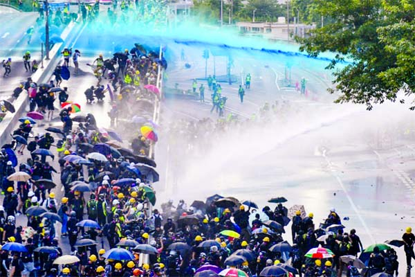 HK returns to violence with tear gas, Molotovs