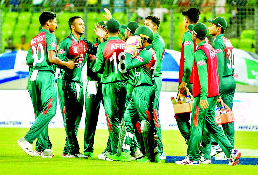 Players of Bangladesh, celebrate after dismissal of the wicket of Hazratullah Zazai ( not in the picture) during the third Twenty20 International match of the OBHAI Tri-nation T20 series between Bangladesh and Afghanistan at the Sher-e-Bangla National Cricket Stadium in the city's Mirpur on Sunday.