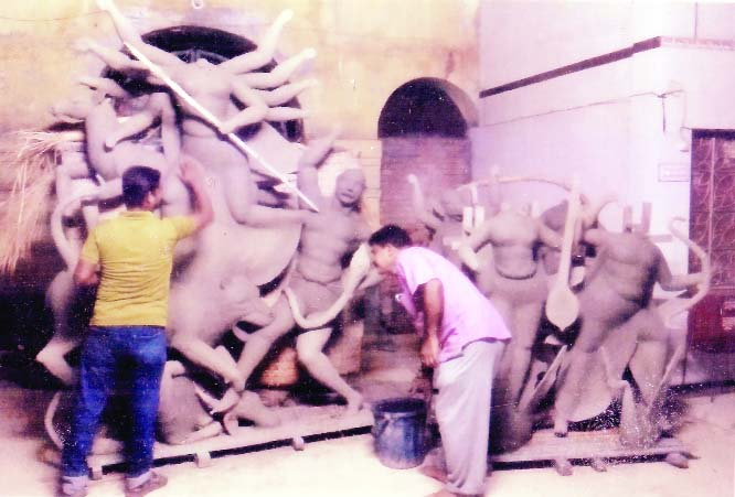 BAGERHAT: Potters are seen busy to complete idols of the Goddess Durga and other deities at local Harishava Mondir Puja pandel.