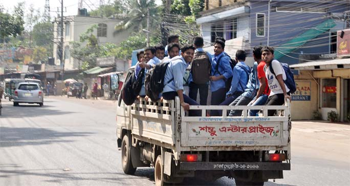 School students going back to home in truck due to crisis of transport in the Port City . This picture was taken from Zakir Hossain Road yesterday.