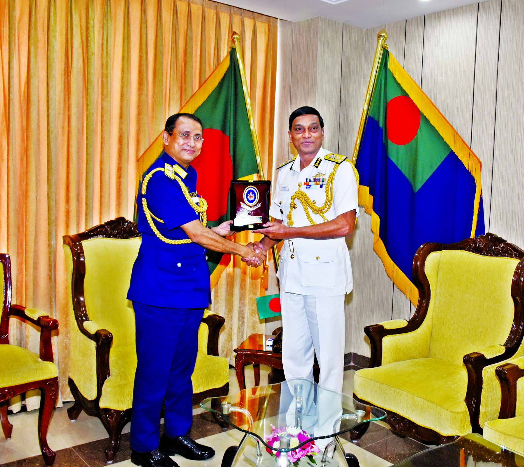 Director General of Indian Coastguard Krishnaswamy Natarajan being greeted with a crest by his Bangladesh counterpart Rear Admiral M Ashraful Haque at the Headquarters of Bangladesh Coastguard in the city on Monday.