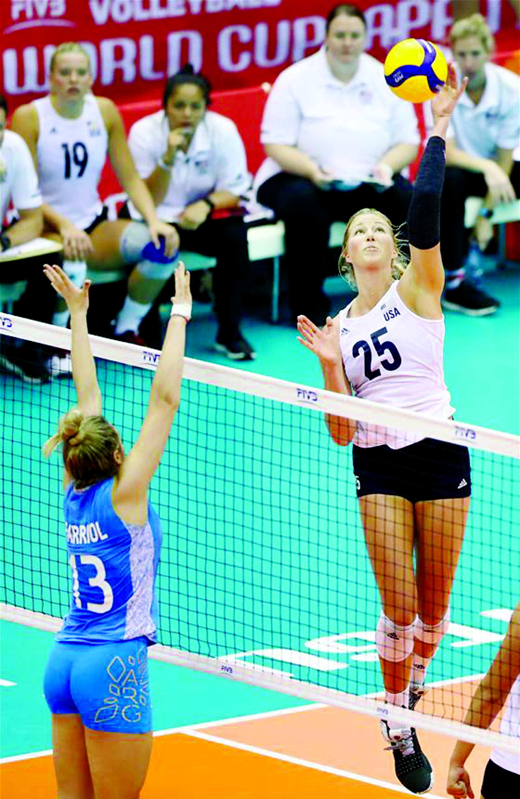 Karsta Lowe (right) of the United States spikes the ball during the Robin Round match between the United States and Argentina at 2019 Volleyball Women's World Cup in Hamamatsu, Japan  on Monday.