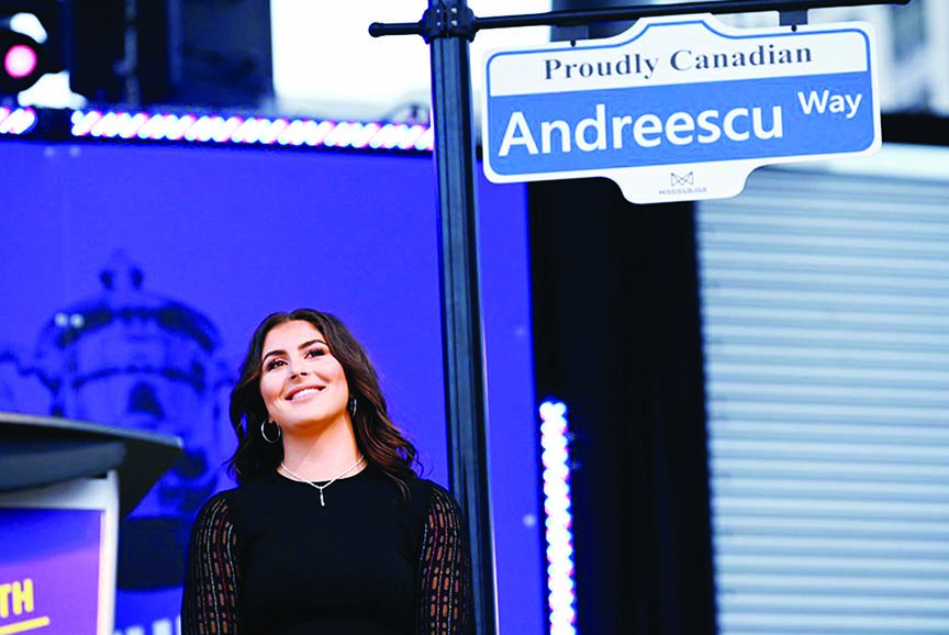 U.S. Open tennis champion Bianca Andreescu with a sign naming a street for Andreescu at the