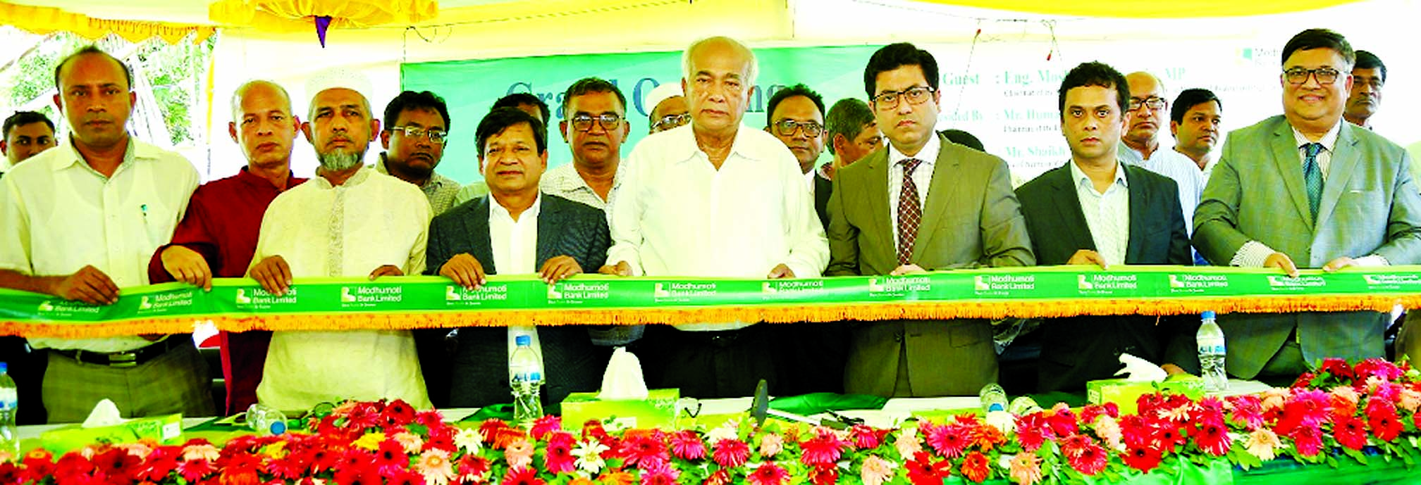 Eng. Mosharraf Hossain, MP, Chairman of the Parliamentary Standing Committee on the Ministry of Housing and Public Works, inaugurating the 38th branch of Modhumoti Bank Limited at Mirsharai in Chattogram on Tuesday as chief guest. Barrister Sheikh Fazle Noor Taposh, MP, EC Chairman, A Mannan Khan, Barrister Imranul Kabir, Sponsor Director, Md. Shafiul Azam, CEO of the bank and local elites were also present.