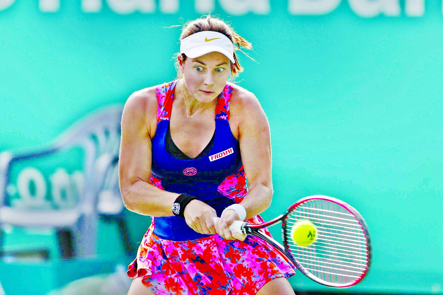 Stefanie Voegele of Switzerland, returns a shot to Ajla Tomljanovic of Australia, during their first round match of the Korea Open tennis championships in Seoul, South Korea on Tuesday.