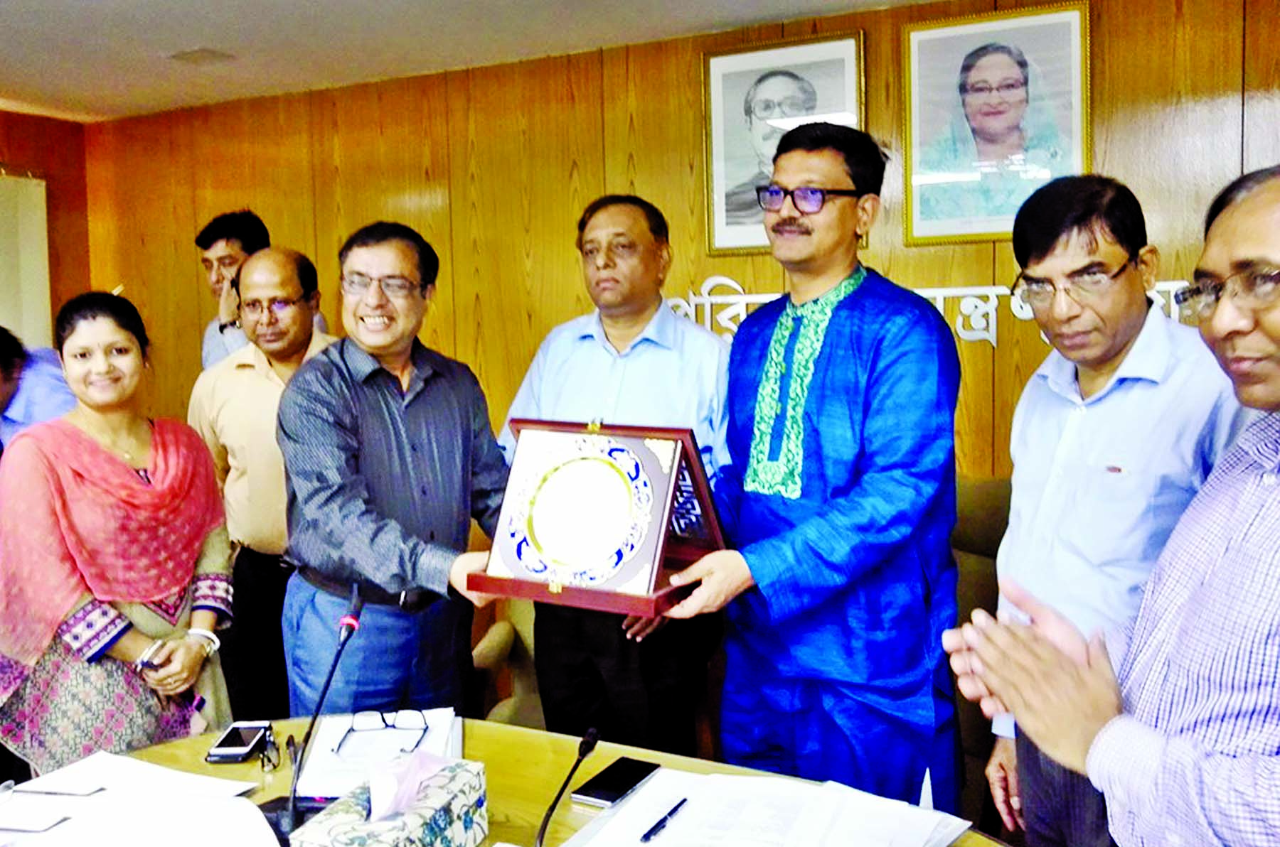 State Minister for Shipping Khalid Mahmud Chowdhury presenting crests to two best project directors of the ministry and agency for 2018-'19 fiscal year at the seminar room of the ministry on Tuesday.