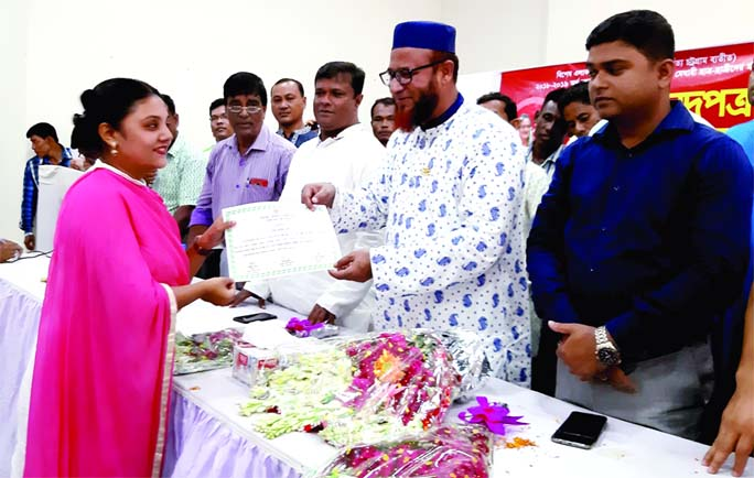 BHALUKA (Mymensingh): Alhaj Kazim Uddin Ahmed Dhonu MP distributing educational materials, certificates and cash among the meritorious  students of different educational institutes from Prim Minister's Special Fund at Upazila Parisahd Auditorium on Monday.